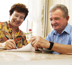 Older couple filing out paperwork